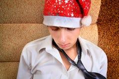 Adolescente triste en Santa Hat Imagen de archivo libre de regalías