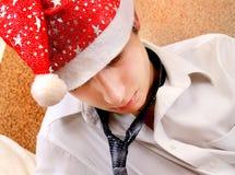 Adolescente triste en Santa Hat Fotografía de archivo libre de regalías