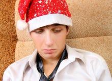 Adolescente triste en Santa Hat Fotografía de archivo