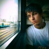 Adolescente triste por la ventana Fotos de archivo
