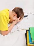 Adolescente triste que hace la preparación Imagen de archivo libre de regalías
