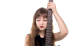 Adolescente triste que sostiene una guitarra Fotografía de archivo libre de regalías