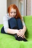 adolescente triste solo Rojo-dirigido Fotografía de archivo