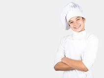 Adolescente vestido como cocinero Foto de archivo