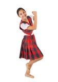 Adolescente vestido con la tela escocesa típica del rojo de la ropa Imágenes de archivo libres de regalías