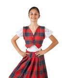 Adolescente vestido con la tela escocesa típica del rojo de la ropa Foto de archivo libre de regalías