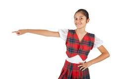 Adolescente vestido con la tela escocesa típica del rojo de la ropa Imagenes de archivo