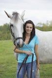 Adolescente y caballo Imagen de archivo