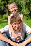 Adolescente y cabrito felices Imágenes de archivo libres de regalías