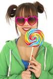 Adolescente y caramelos Foto de archivo libre de regalías