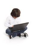 Adolescente y computadora portátil Imagen de archivo