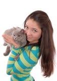 Adolescente y gato. Imagen de archivo