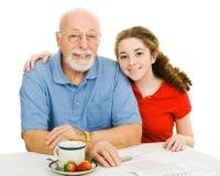 Adolescente y Grandpa Fotos de archivo