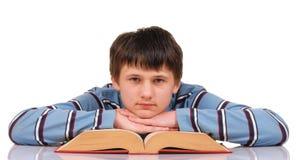 Adolescente y libro Foto de archivo libre de regalías