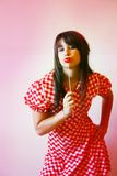Adolescente y lollipop jovenes Imagen de archivo libre de regalías