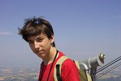 Adolescente y monóculo. Fotos de archivo