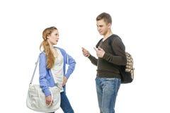 Adolescente y muchacha aislados en blanco Imagen de archivo