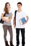 Adolescente y muchacha con los libros de la universidad Imagen de archivo