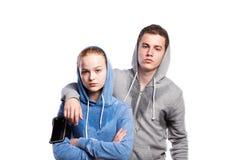 Adolescente y muchacha en camisetas Tiro del estudio, aislado Imágenes de archivo libres de regalías
