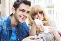 Adolescente y mujer en café Imágenes de archivo libres de regalías
