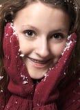 Adolescente y nieve Imagen de archivo libre de regalías