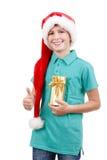 Adolescente y regalo de la Navidad Foto de archivo