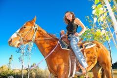Adolescente y su caballo Foto de archivo libre de regalías