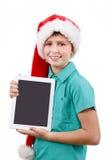Adolescente y tableta en blanco Imagenes de archivo