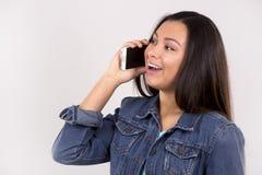 Adolescente y teléfono móvil Fotografía de archivo libre de regalías