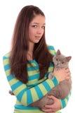 Adolescente y un gato. Imagenes de archivo