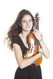 Adolescente y violín en estudio con el violín blanco del fondo Imágenes de archivo libres de regalías