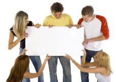 Adolescentes com placa Imagem de Stock Royalty Free