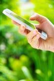 Adolescentes con el teléfono móvil Imagenes de archivo