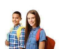 Adolescentes con las mochilas que sostienen los cuadernos en el fondo blanco Fotos de archivo libres de regalías