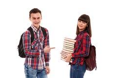 Adolescentes con las mochilas y los libros Foto de archivo