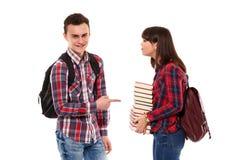 Adolescentes con las mochilas y los libros Fotos de archivo libres de regalías