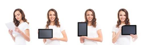 Adolescentes con las tabletas en blanco Foto de archivo