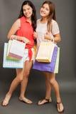 Adolescentes con los panieres Imagen de archivo libre de regalías