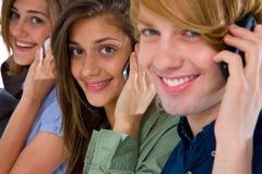 Adolescentes con smartphone Imágenes de archivo libres de regalías