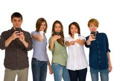 Adolescentes con smartphone Foto de archivo