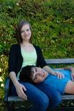 Adolescentes de reclinación Imagen de archivo libre de regalías