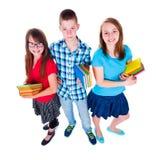 Adolescentes de sorriso que olham acima Fotografia de Stock