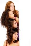 Adolescentes diversos con la muestra en blanco Fotografía de archivo libre de regalías