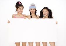Adolescentes e sinal Fotografia de Stock