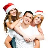 Adolescentes en el sombrero de Santa Fotografía de archivo