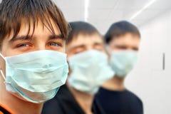 Adolescentes en máscara Imagen de archivo