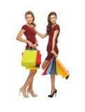 Adolescentes en vestidos rojos con los panieres Imagen de archivo libre de regalías
