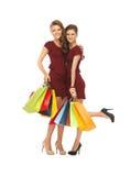 Adolescentes en vestidos rojos con los panieres Fotos de archivo libres de regalías