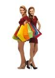 Adolescentes en vestidos rojos con los panieres Fotografía de archivo libre de regalías
