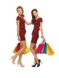 Adolescentes en vestidos rojos con los panieres Foto de archivo